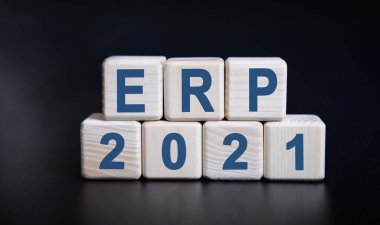 ERP 2021 text on wooden cubes on a black background with reflection.