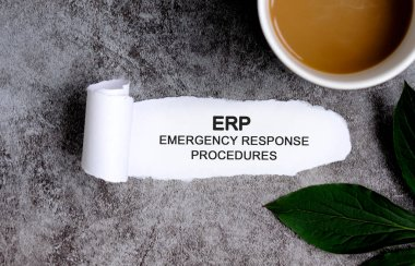 ERP EMERGENCY RESPONSE PROCEDURES with cup of coffee and green leaf