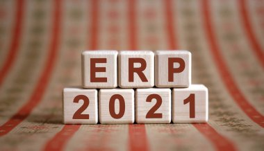 ERP 2021 text on wooden cubes on a monochrome background with reflection.