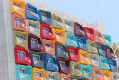 Spectacular, modern colorful building with balconys in different