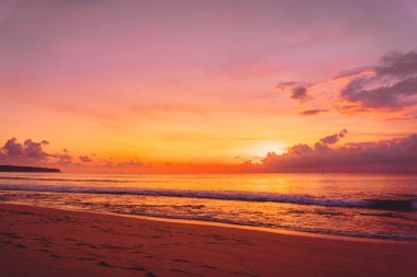 Colorful sunset or sunrise at tropical beach with ocean in Bali