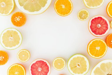 Citrus pattern of lemon, orange, grapefruit, sweetie and pomelo fruits on white background. Flat lay, top view.