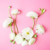 Fotografie Floral frame made of white flowers on pink background. Flat lay, top view. Spring background