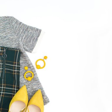 Women fashion cloth and accessories. Yellow shoes, earrings and blouse. Flat lay, top view.