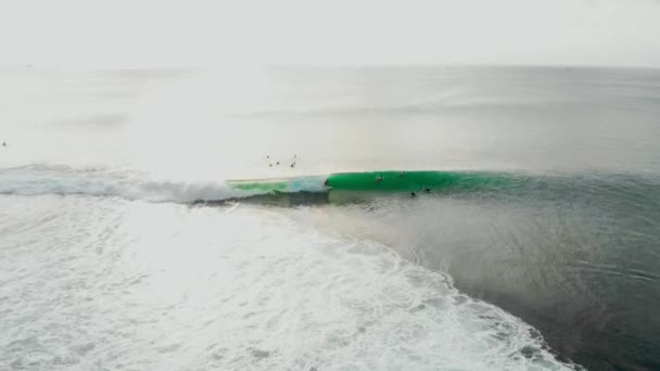 Aerial view at ocean with barrel wave and surfer ride on wave