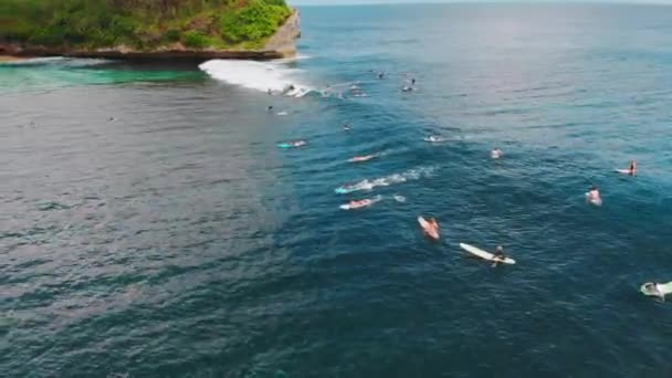 Aerial view with wave in ocean and surfers. Waves and surfing