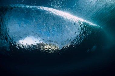 Barrel wave crashing in ocean. Underwater wave texture.
