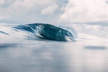 Ocean barrel wave in ocean. Breaking wave for surfing in Tahiti