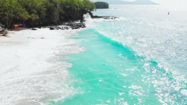 Sandy beach with turquoise ocean and waves, aerial view