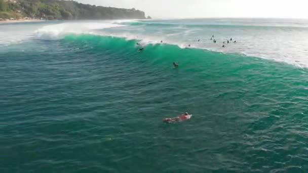 Aerial view of wave in ocean and surfers. Surfing and waves