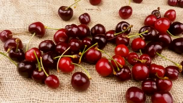 Red fresh cherry on sackcloth surface.