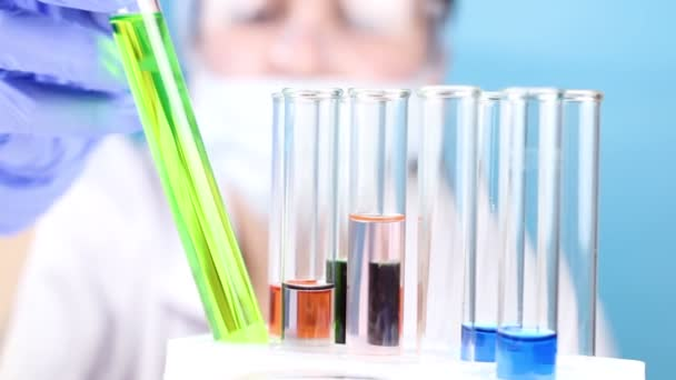 Scientist take test tube with liquid in laboratory. Close up.