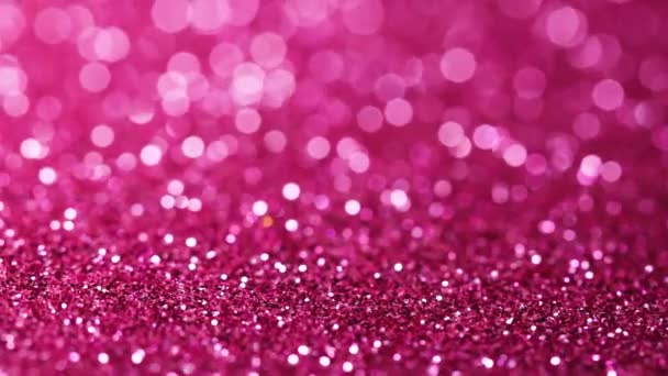 Purple glitter texture rotating. Shiny abstract background.