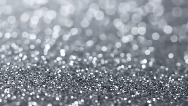 Stříbrné třpytky rotační textury. Lesklé pozadí abstraktní.