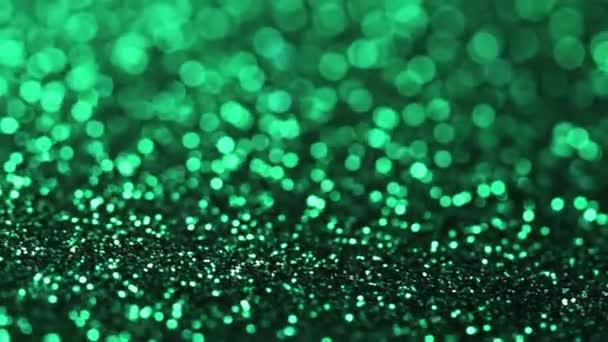 Zöld csillogó textúra forgatható. Absztrakt fényes háttér.