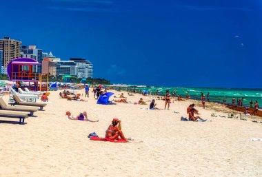 MIAMI BEACH, FLORIDA, USA, May 03 2019: People at beach during sunny day in Miami Beach, Florida, USA.