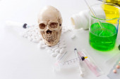 Substance Abuse Harmful. Drug addiction. Skull and medicin danger. Pile of medical supplies. Scientists experiment with drugs.