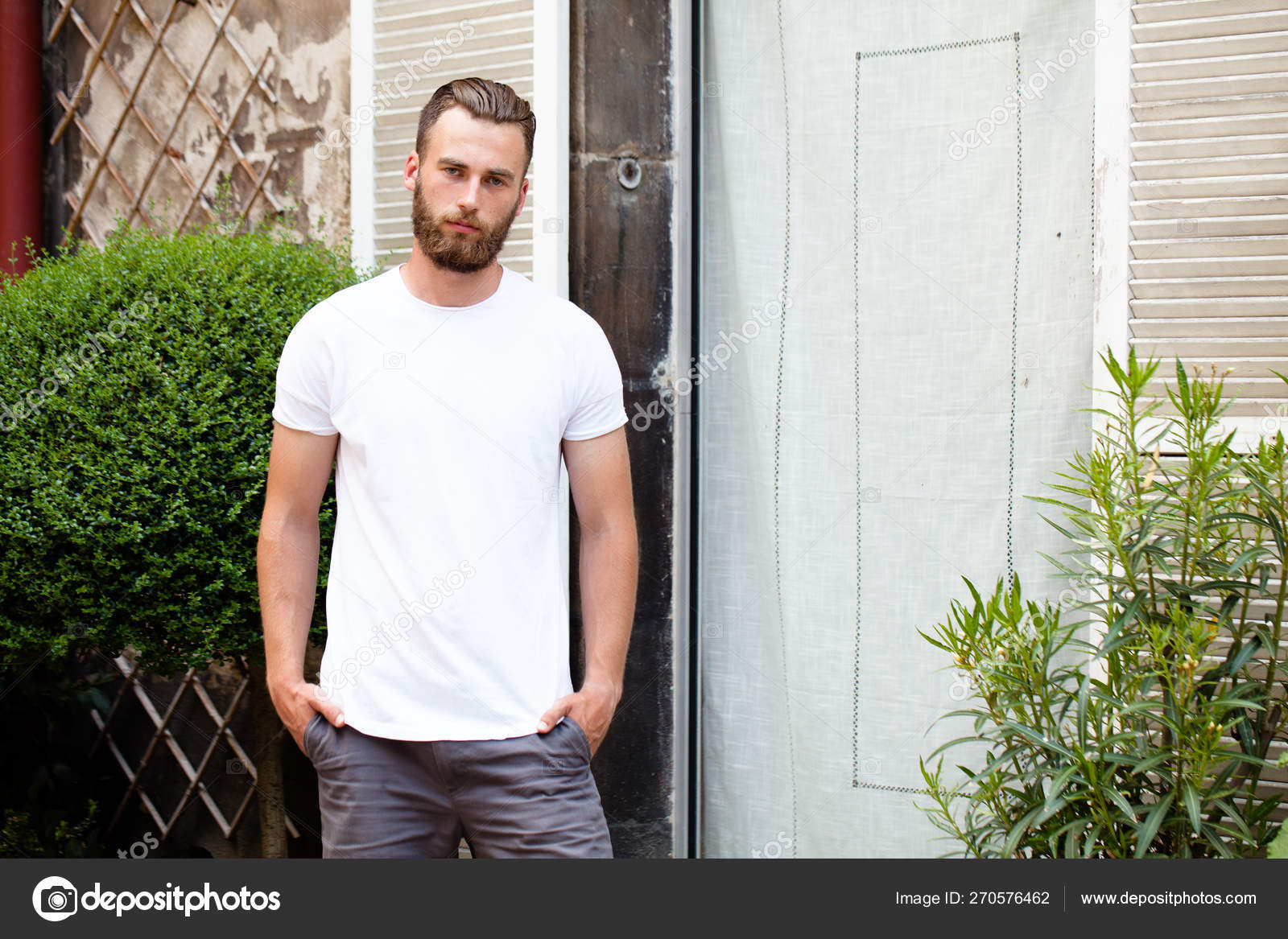 c73be3202379 Hipster handsome male model with beard wearing white blank t-shirt with  space for your logo or design in casual urban style — Photo by ...