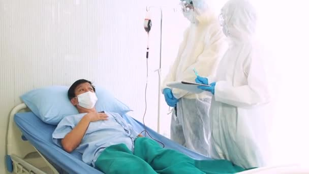 The doctor takes care a sick patient, coughing from coronavirus on hospital bed. sick man on a hospital bed.