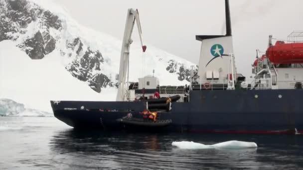 People on ship in ocean of Antarctica.