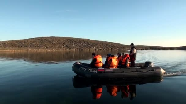 People in a rubber boat in Ocean on New Earth Vaigach.