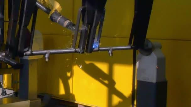 Metal iron laser argon welding on industrial CNC machine in factory.