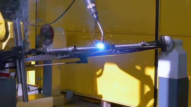 Laser argon welding of metal iron on industrial CNC machine in factory.