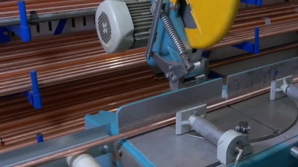 Cutting metal copper pipes on industrial CNC machine.