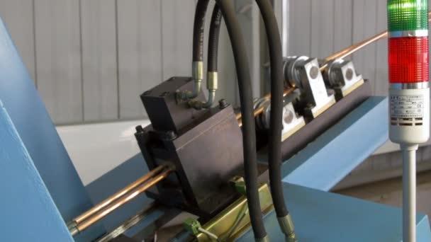 Bending of metal copper tubes on industrial machine in factory.