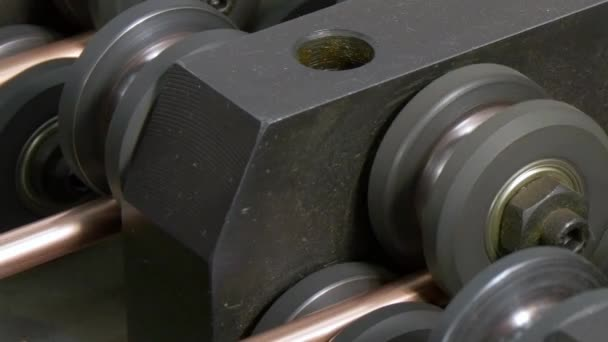Bending of metal copper tubes on industrial CNC machine. in factory.