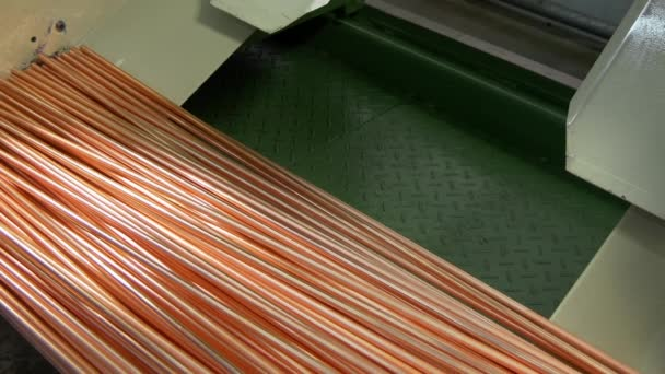 Copper pipes on industrial machine in factory.