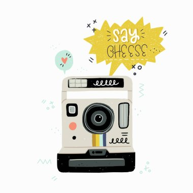 Cartoon style vector illustration of the retro instant photo camera and Say Cheese hand lettering. Great design element for sticker, card or poster. 80s and 90s nostalgic drawing and inscription.