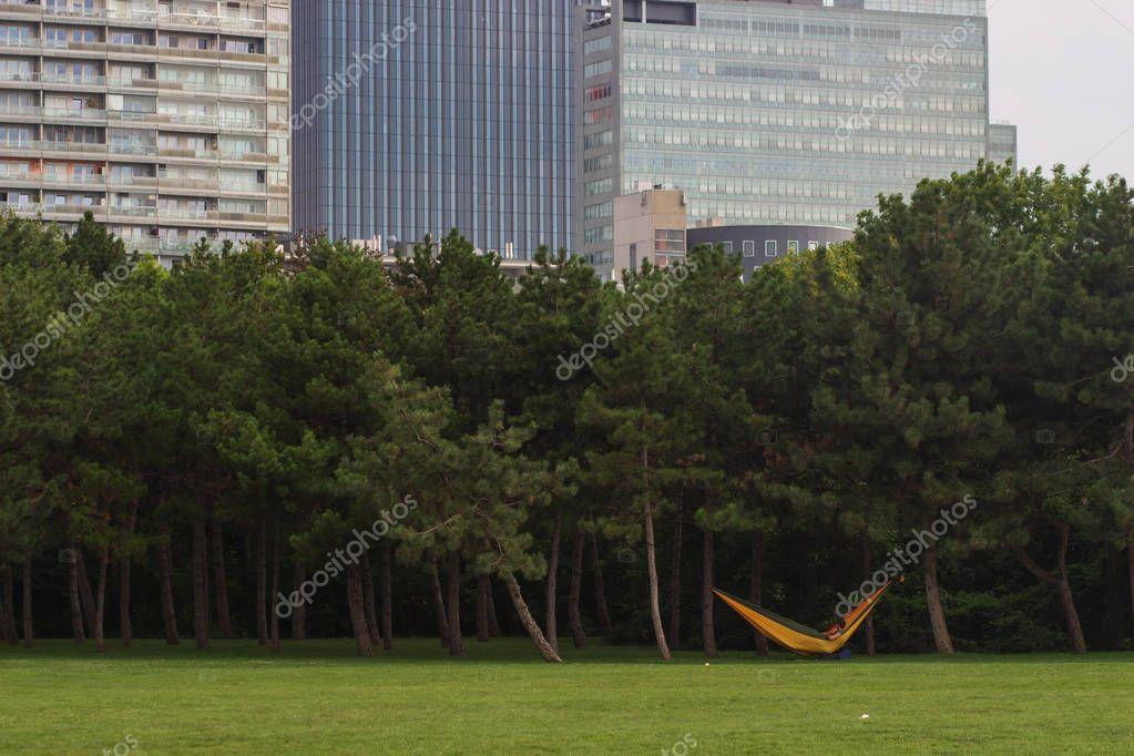 resting area inside modern park with public hammocks