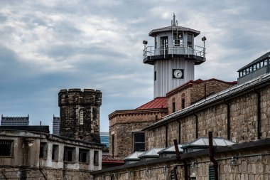 Watch tower of a penitentiary before a storm