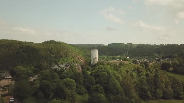 St. Matthias Church and castle on a hill in Reifferscheid Germany Aerial