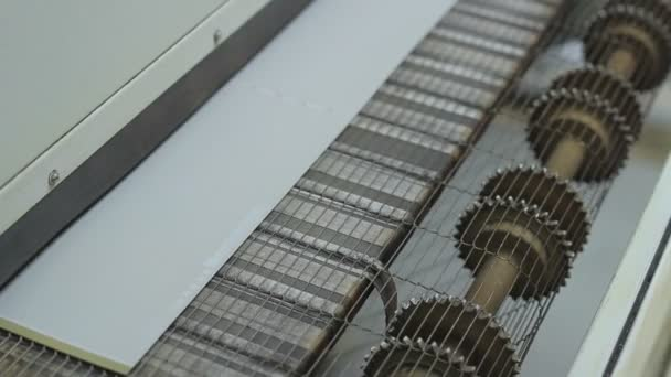 close-up footage of Industrial printing of leaflets and magazines