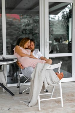 Young couple in love on the terrace of their home.