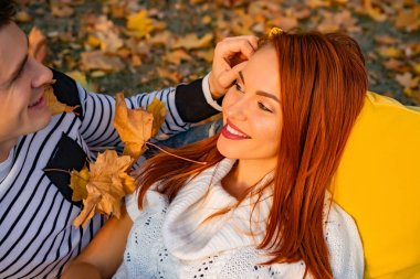 young couple in love. Lovers man and woman in the park in autumn, tenderness, hugs and kisses, happy couple.