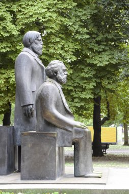Karl Marx and Friedrich Engels monument in the Marx-Engels-Forum, a public park in the central Mitte district of Berlin, Germany stock vector