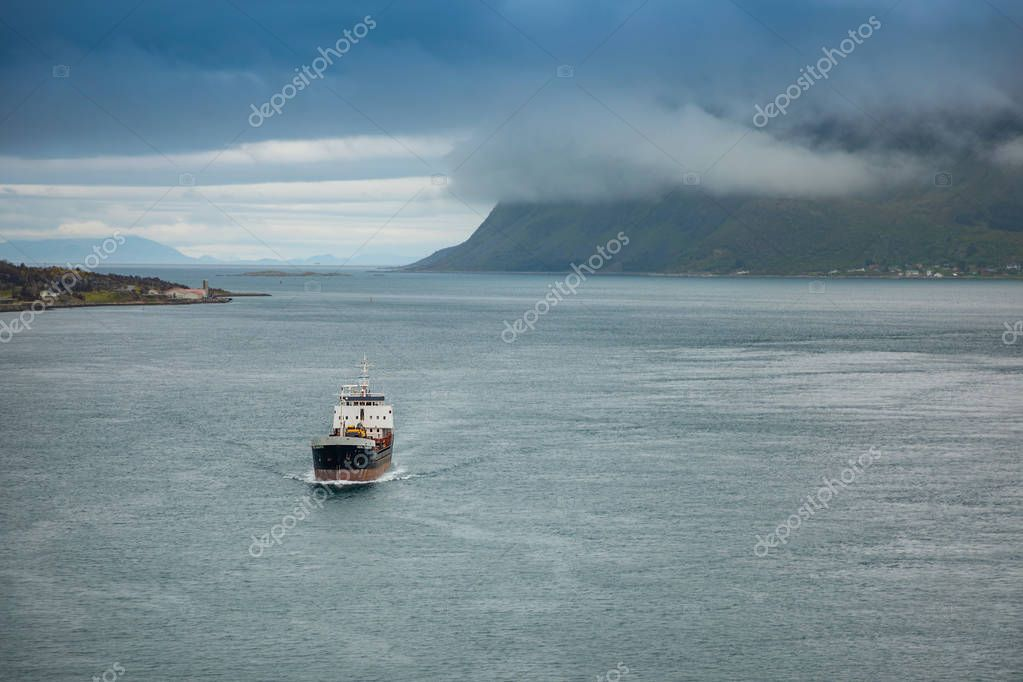 Svolvaer, Norway - 21.06.2018: Ship in Norway, with panorama view to mountains in the background