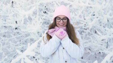 Beautiful young blonde woman in glasses pink hat 834511742f78