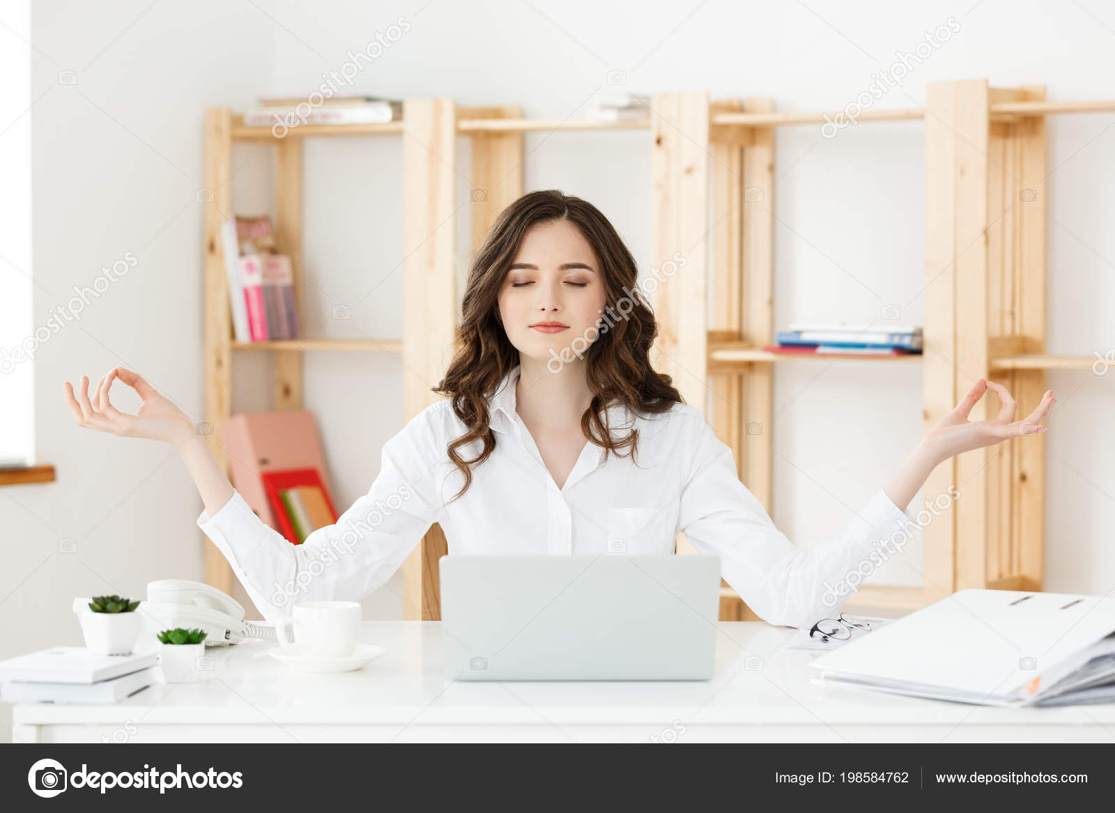 Business And Health Concept Portrait Young Woman Near The Laptop Practicing Meditation At The Office Desk