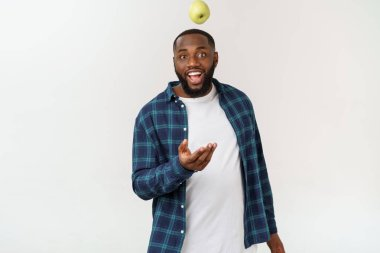 African man with green apple isolate over white background.