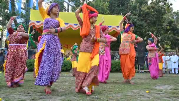 Kolkata, West Bengal, India - 10th March 2020 : Bengali girls dressed in colorful Indian dresses, dancing at Dol utsab or Holi festival. Celebration of arrival of spring in India. 4K stock footage.