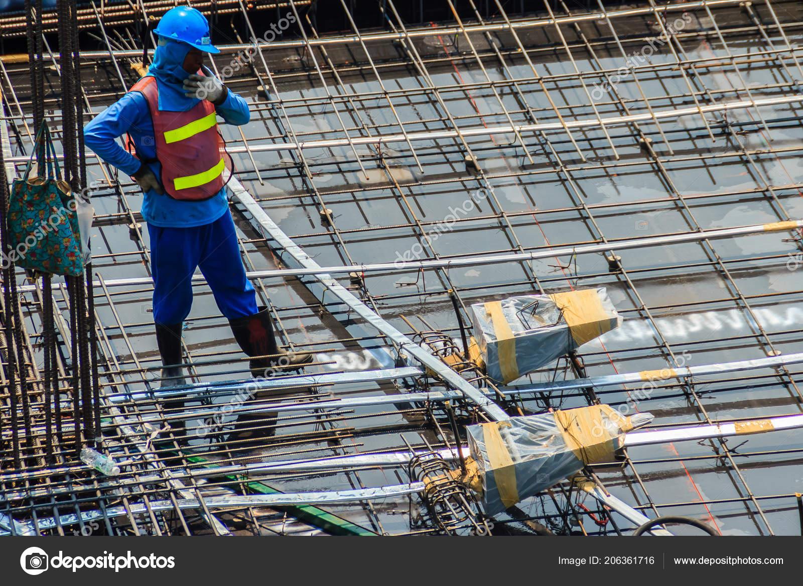 Unidentified Worker Used High Pressure Machine Clean Floor Slab