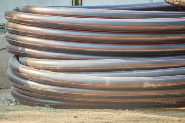 HDPE pipes for water supply and electrical conduit at construction site