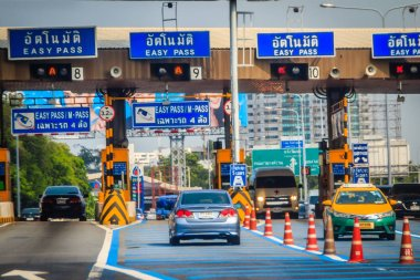 Bangkok, Thailand - March 26, 2018: Extra blue easy pass lane to paying the easy pass tolls fee at the automated tollbooth that faster and easier than the normal cash payment lane.