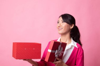Young Asian woman open a gift box.