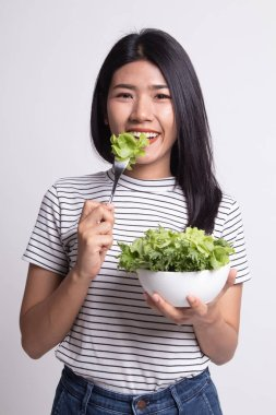 Healthy Asian woman with salad.