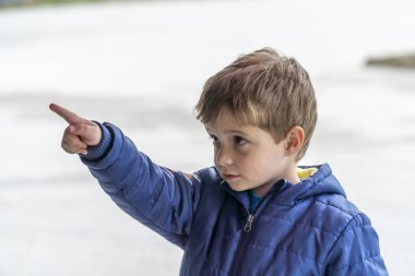 Small child pointing at something